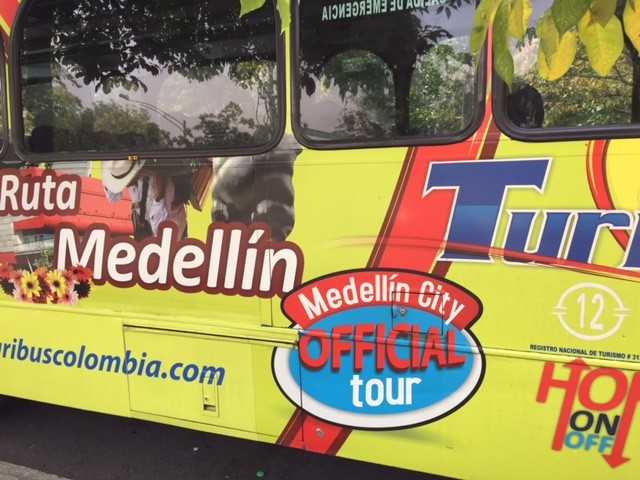You will tour Medellín in a bus like this